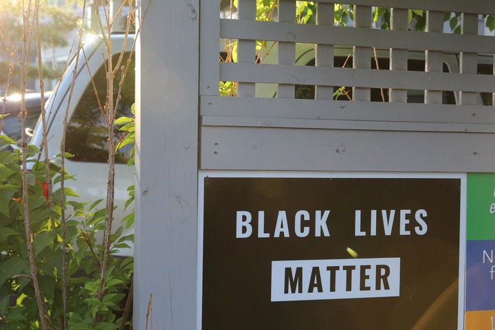 a black lives matter sign on a fence in Cambridge